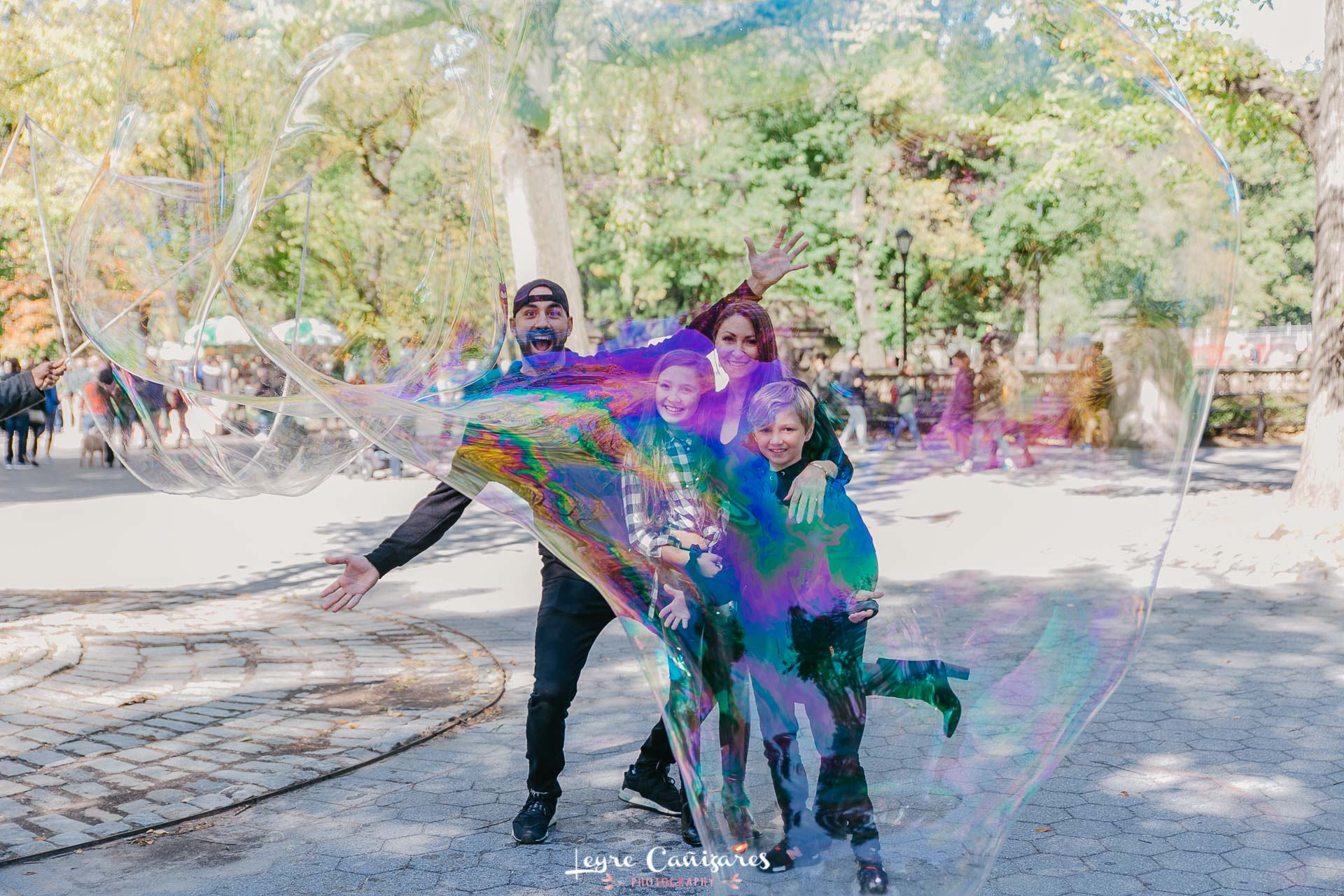 family session in central park with giant bubbles