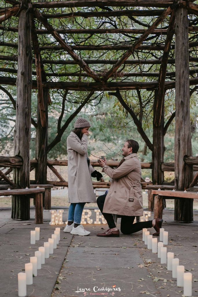romantic surprise proposal at The Cop Cot with candles, central park
